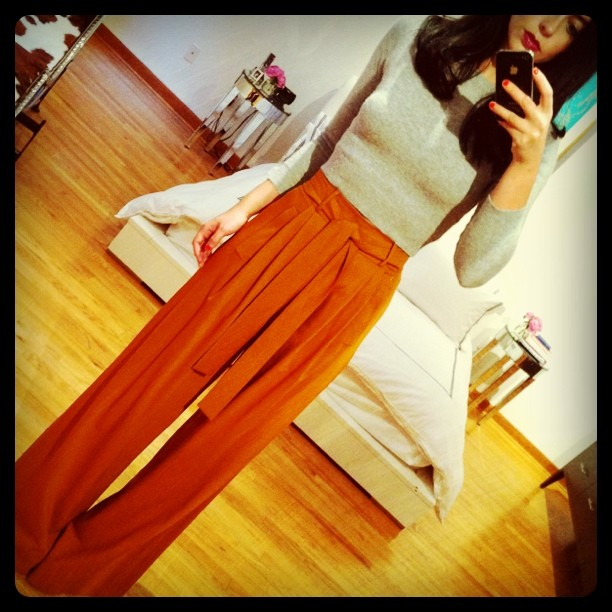 luckymag :      oscarprgirl :     high waisted trouser. (Taken with  instagram )     That lip color is fantastical, see you on 7th ave.     gonna rock this come fall. if my waist ever gets that small.