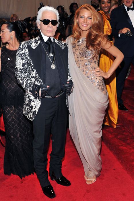 irockirockirock :      Karl Lagerfel  d  wears a Tom Ford suit, and  Blake Lively  wears Chanel Haute Couture.   2011 Met Gala.   Blake looks like a Mermaid Roman goddess!tralala! PS. I dont like her red hair. Bleh.     i know. she was bombshell blonde and now she is all blaaaaahhhh with the red hair. and her tan just blends in with it all. gross, blake. just gross. (i totally am naming my first child blake…. and secretly hoping i only have girls)