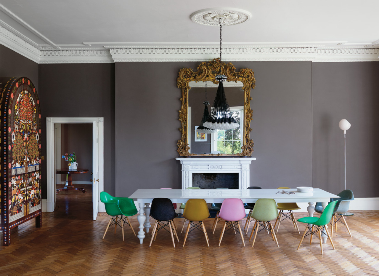 designismymuse :     Old meets new… Dinder House      multicolored chairs. yes, please.