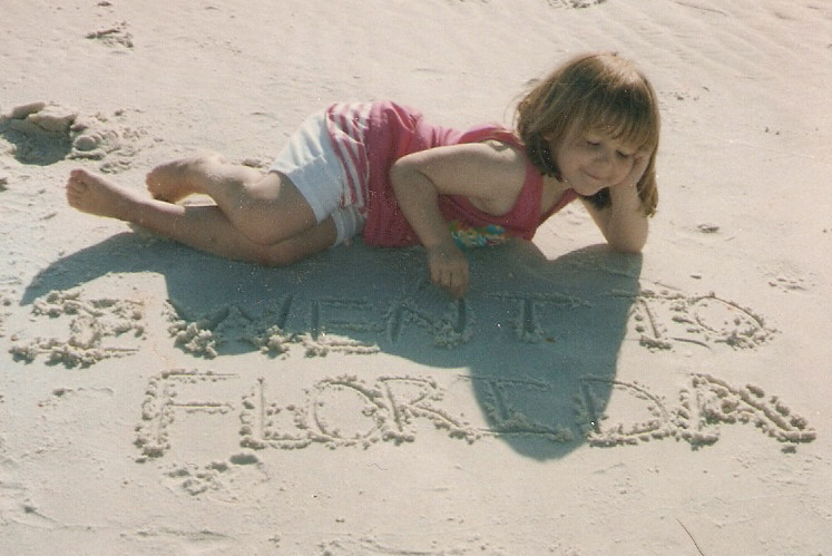 15 years ago. Cape San Blas, Florida.  family trip every year from '93 to '07.  two older sisters always posed me like this.  ha.