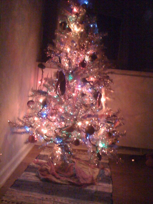 One of three awesome trees in our house. A little tacky since it's in the studio.