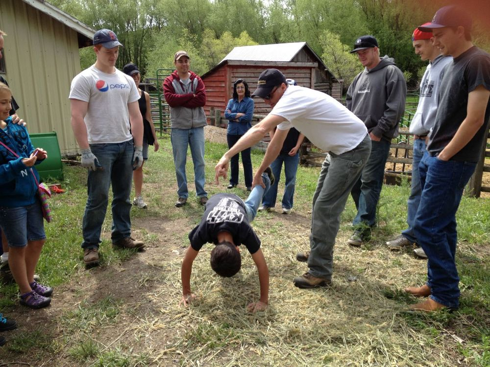 Cole, our calf impersonator, during a lesson on how to catch calves and flip them over without hurting them or yourself....