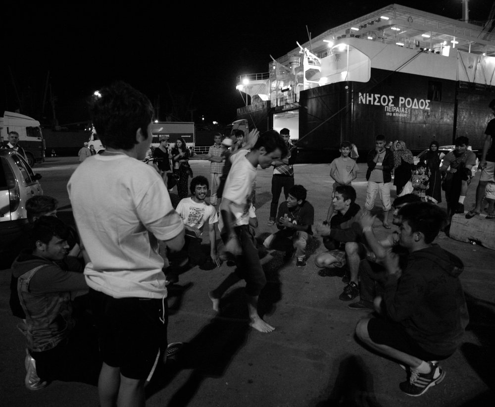 Young Afghan and Syrian Refugees Dancing, Refugee Camp at Piraeus Port, Athens, Greece, June 2016
