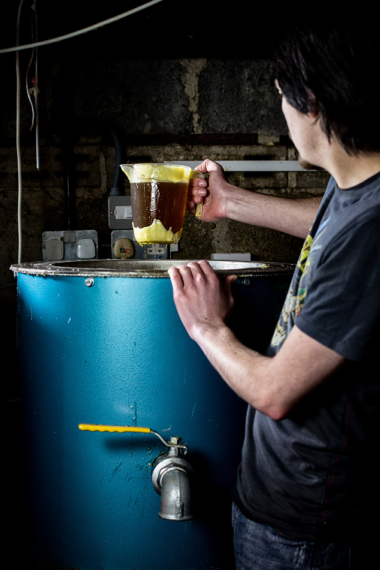 1.  Lumps of natural beeswax are placed in a drum and melted
