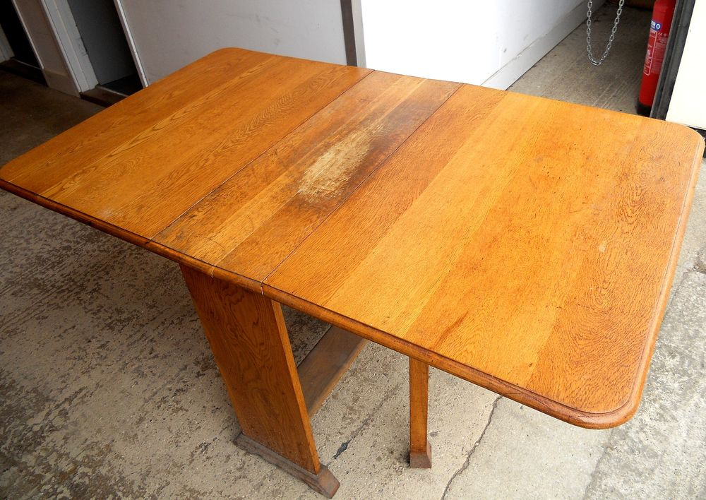 A badly neglected oak table in need of some attention