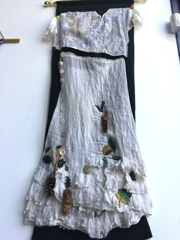 You've got to go back to mother earth. Vintage materials, found botanicals with hand embroidery