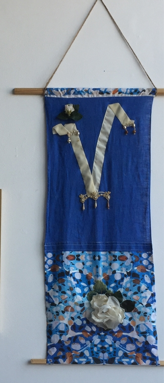 blue valor. Hand printed fabric sewn with vintage ribbons and beads