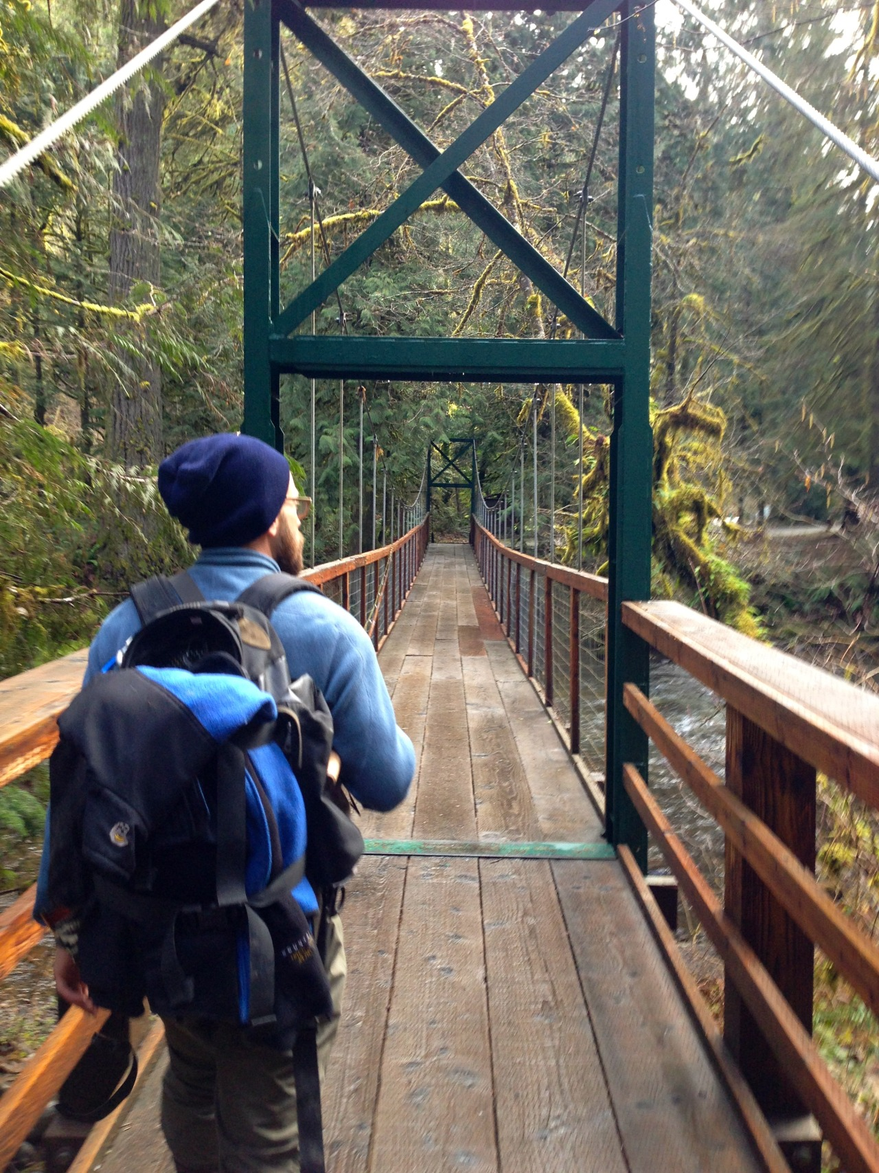 Jeff and I hiking across a suspended bridge to the next spot.