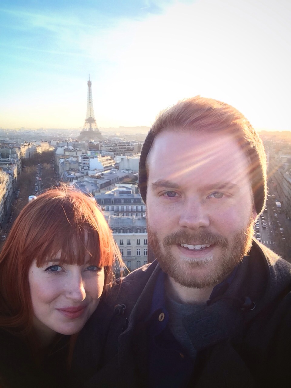 Top if the Arc de Triomphe with the girl