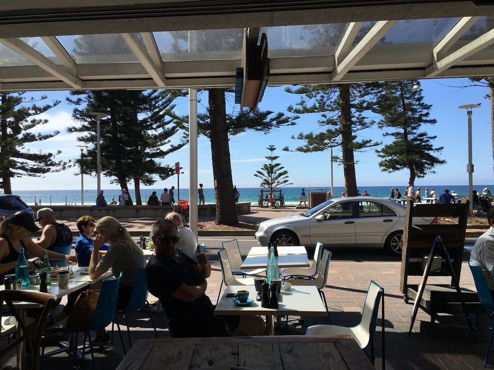 Watching manly hockey at Manly Beach