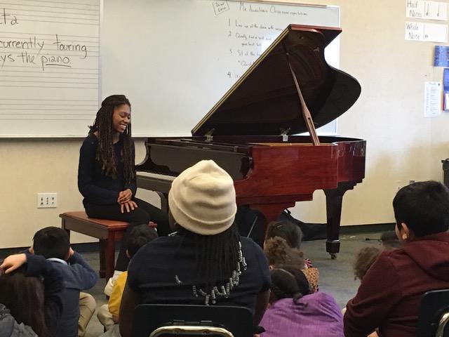 Isata talks to the BRAVO students at Rosa Parks Elementary school.