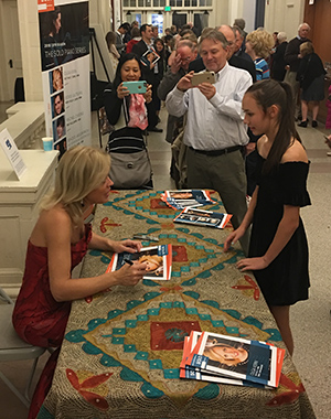 Olga greets a young member of the public following her Saturday performance.