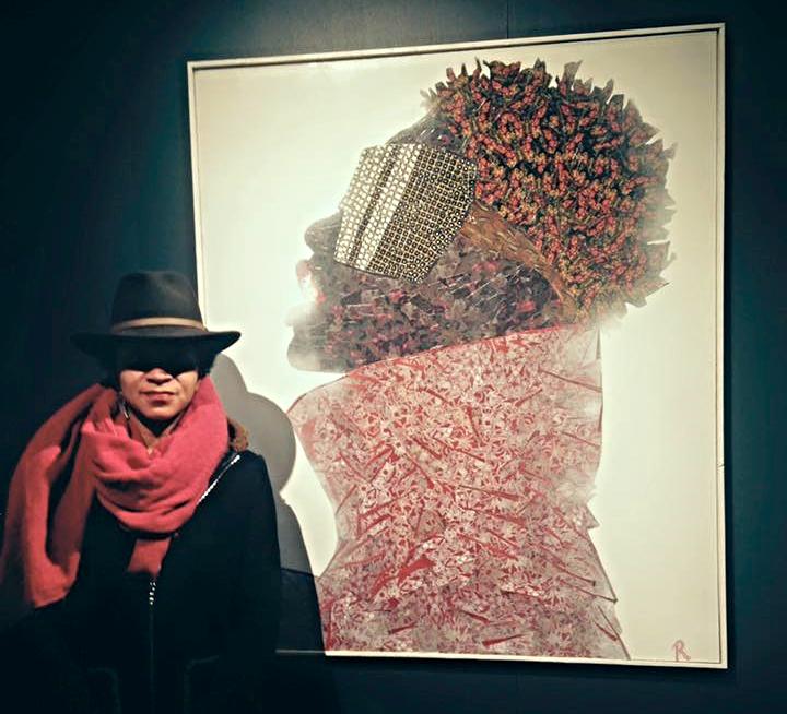 Reisha with her winning artwork,  Black Ski Summit  at the 2016 Black Creativity Exhibit.