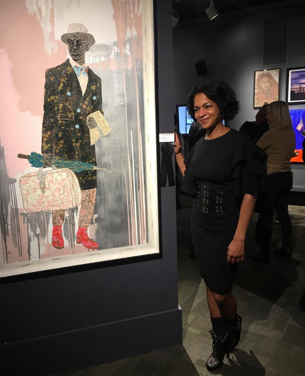 Reisha in front of her 2nd Place award winning 2018 work, Dear John.