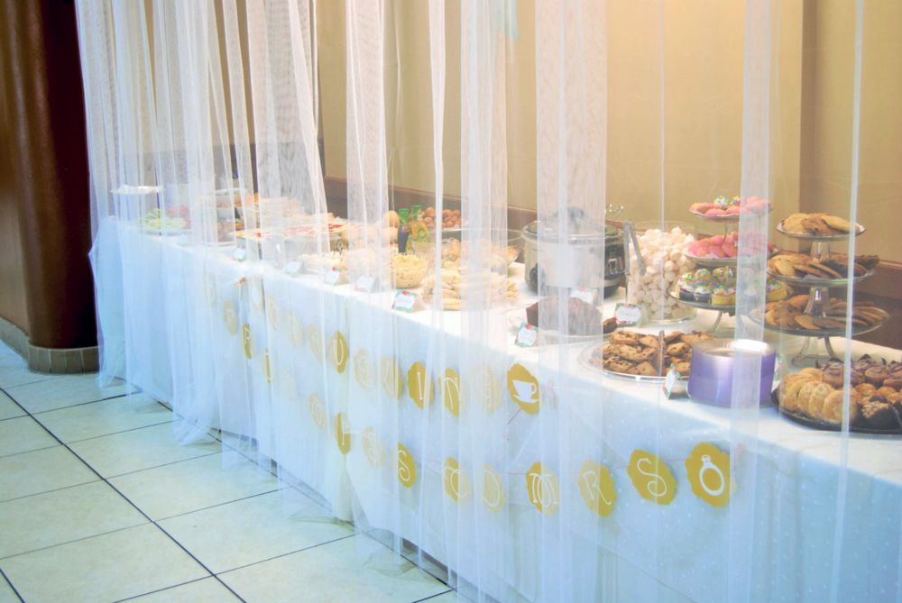 In order to ensure that guests would wait until the celebrated Bride-To-Be's arrival to feast on the yummy sandwiches and treats, a sheer curtain was placed in front of the buffet.