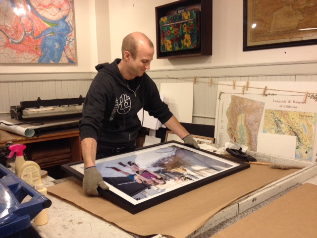 Dave Green, rockstar, helping frame. (look at him being smart with the gloves to handle the glass.)