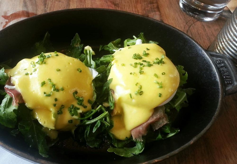 eggs benedict: cheddar bacon biscuits, prosciutto, arugula, eggs, hollandaise sauce