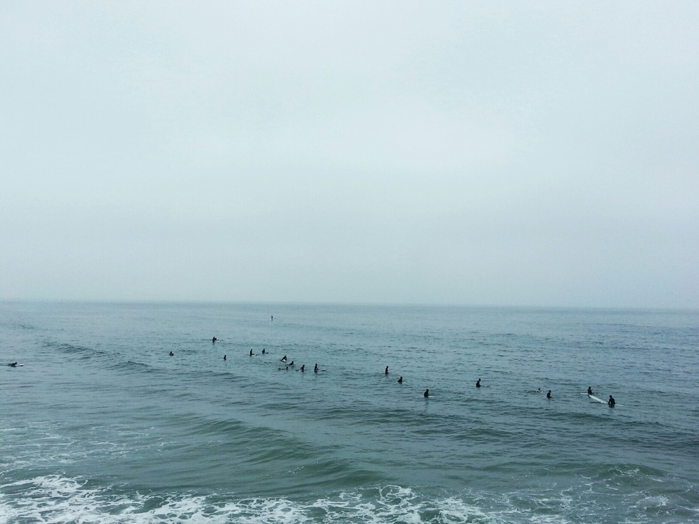 surfers waiting for the next wave