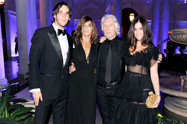 Carine Roitfeld with her family: (left) son Vladimir Restoin Roitfeld, (right) partner, Christian Restoin and (far right) daughter Julia Restoin Roitfeld.