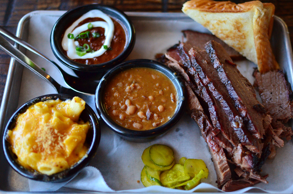 Texas styled brisket with sides of beans, mac 'n cheese, and their famous Chomp and Stomp chili.
