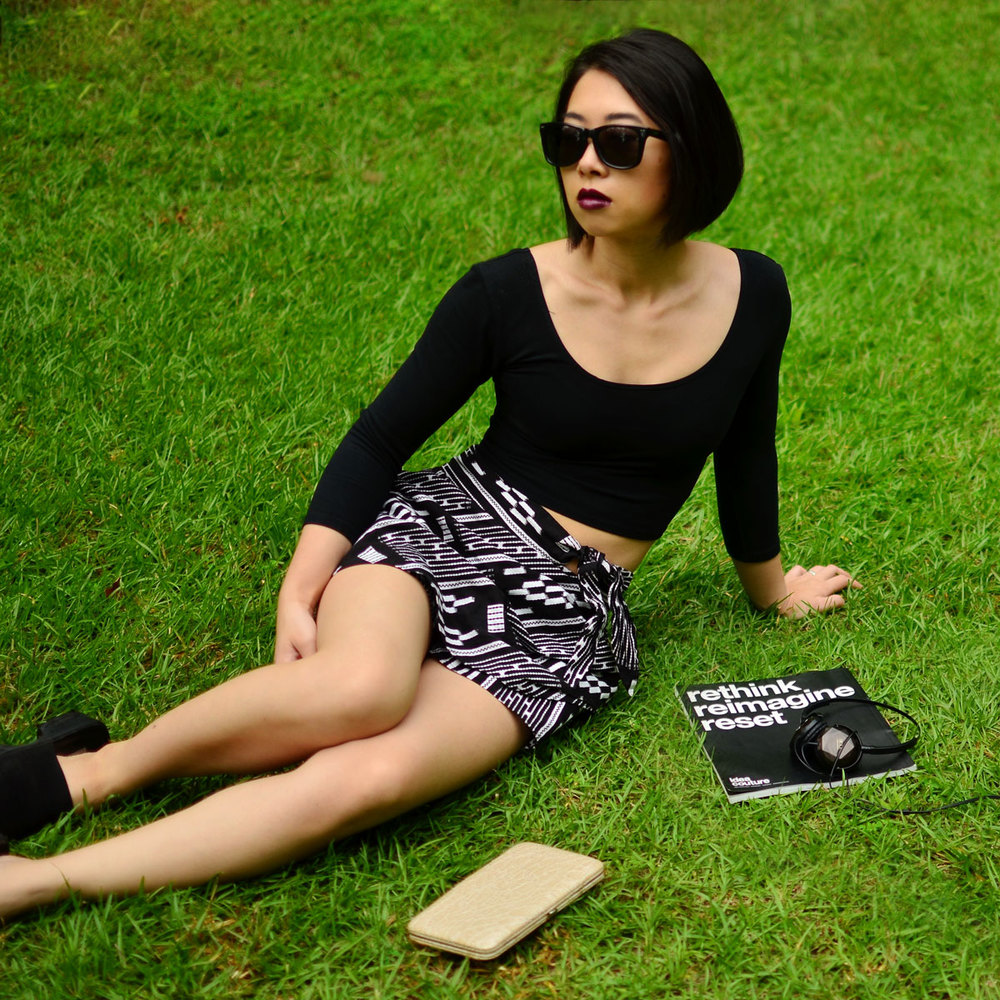 Relaxing in the grass in my groceries apparel crop top and dolce vita geometric skirt.