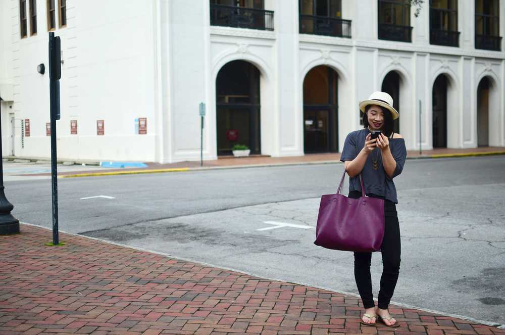 Aritzia fedora hat with Gap slub gray tee, Closed Denim skinny pusher jeans, and Olukai Kumu sandals.