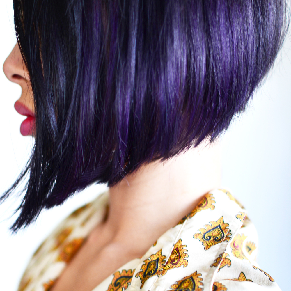 Purple hair highlights on an angled bob.