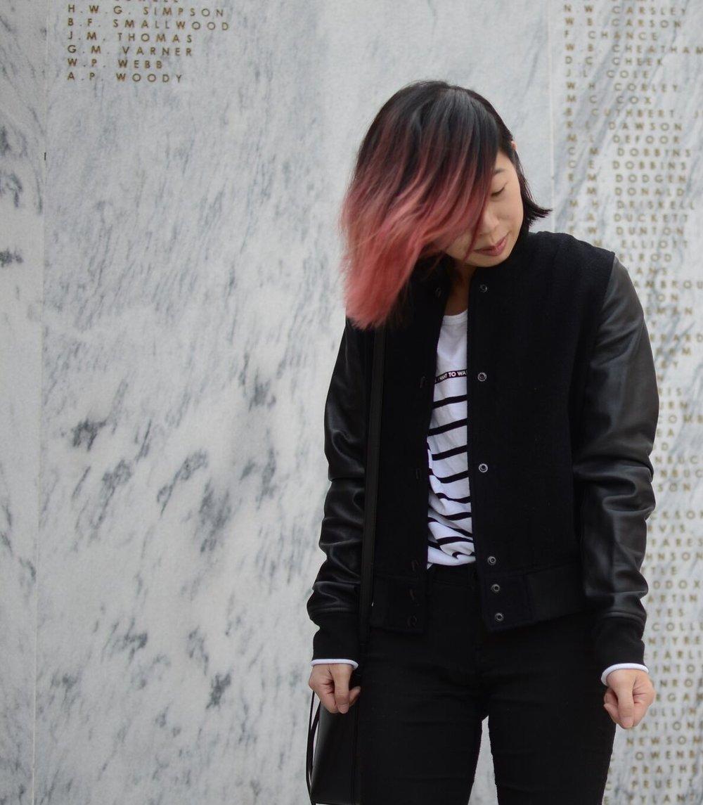 Ally Hwang standing in front of Veterans Memorial