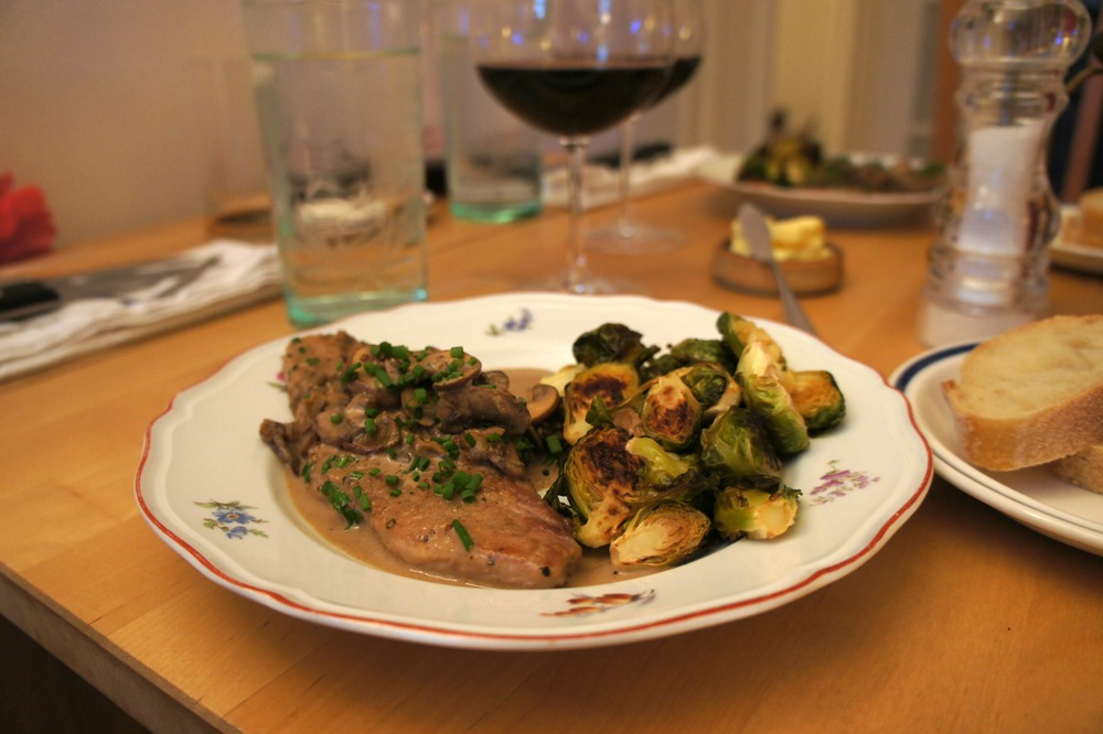 Pork with mushroom cream sauce and roasted brussels sprouts