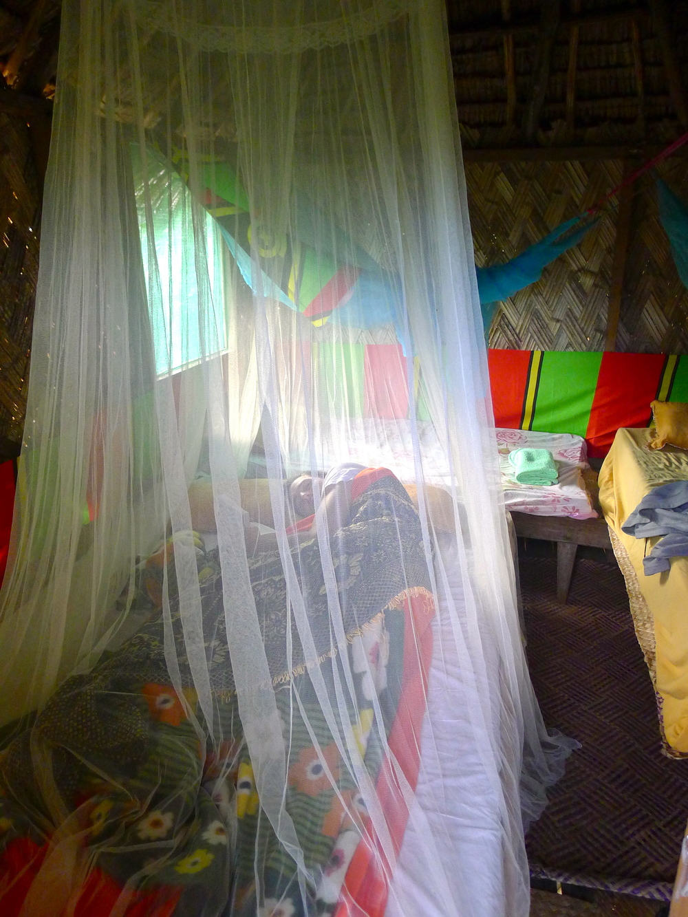 INSIDE THE TREEHOUSE HUT. MOSQUITO NETS AND ALL.
