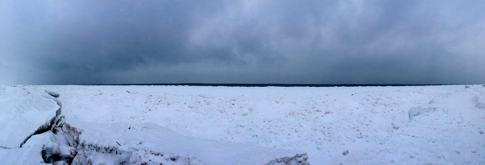 Frozen Lake Michigan near Point Betsie - the thin strip of dark blue is open water in the distance.
