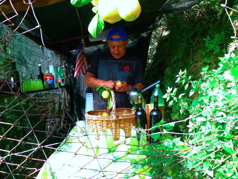 A man selling limoncello along the hiking trails in Cinque Terre, Italy.