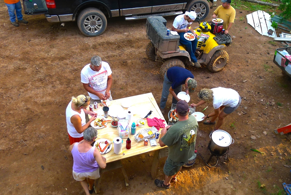 The traditional low-country-boil night at the new camp with local friends.
