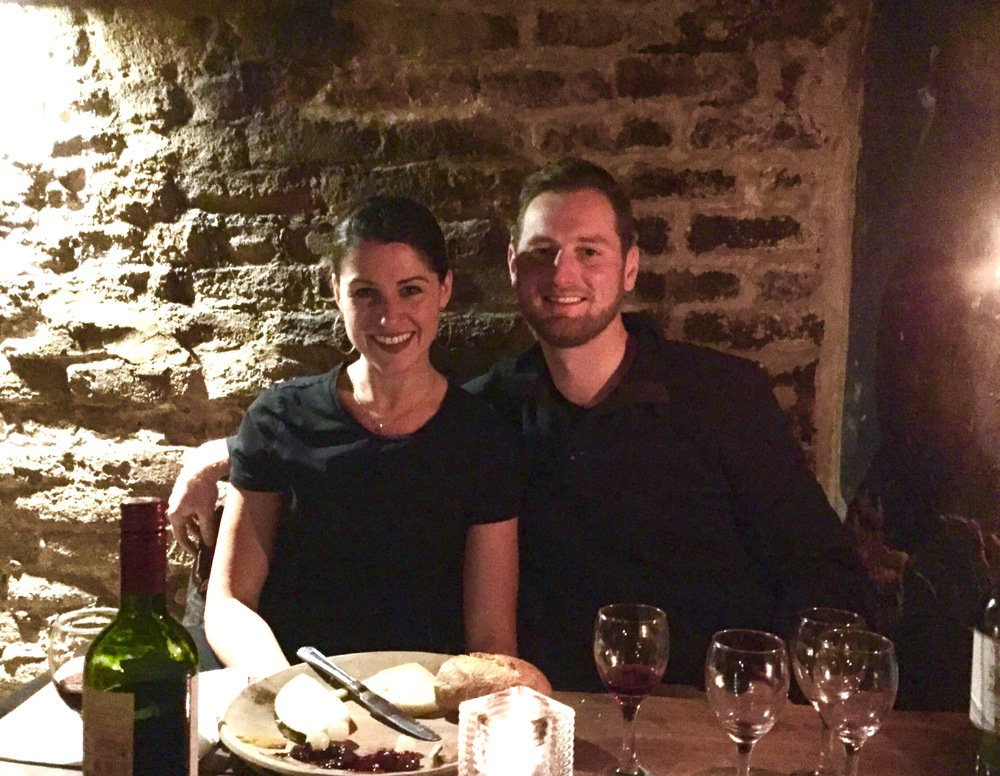 The happiest Mr. & Mrs. in Gordon's Wine Bar in London, England.