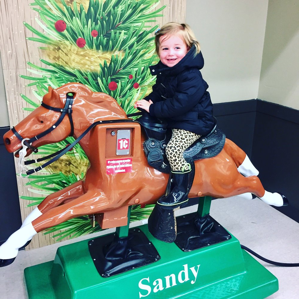 Sandy the horse at our local Meijer store. Natalie is in love!
