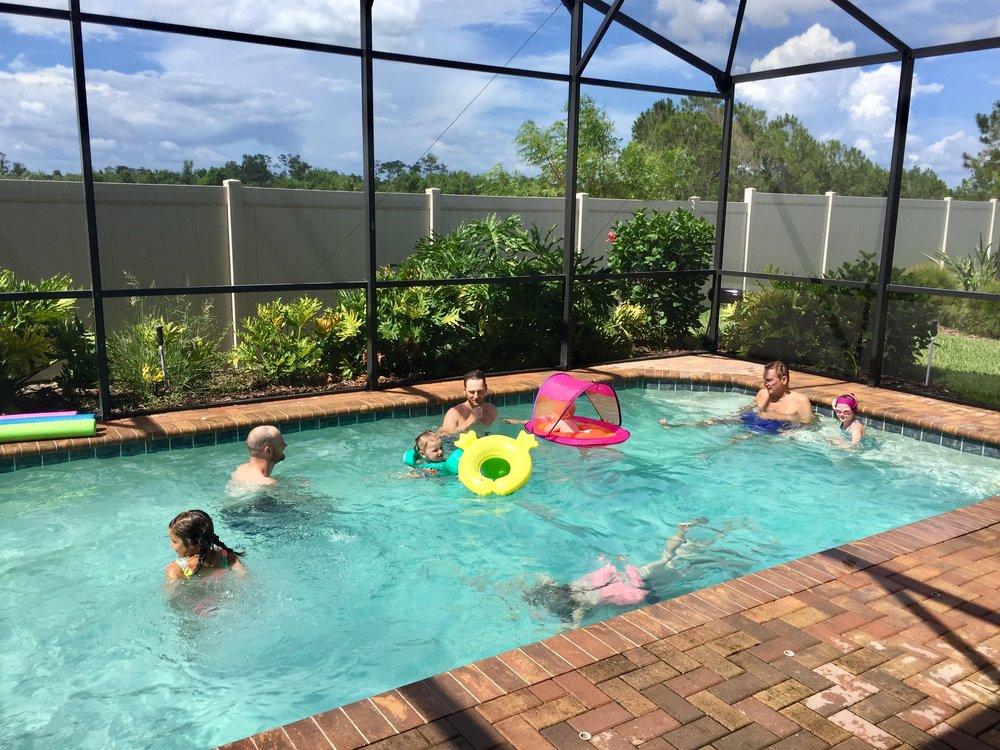 Disney airbnb pool group pic.jpg