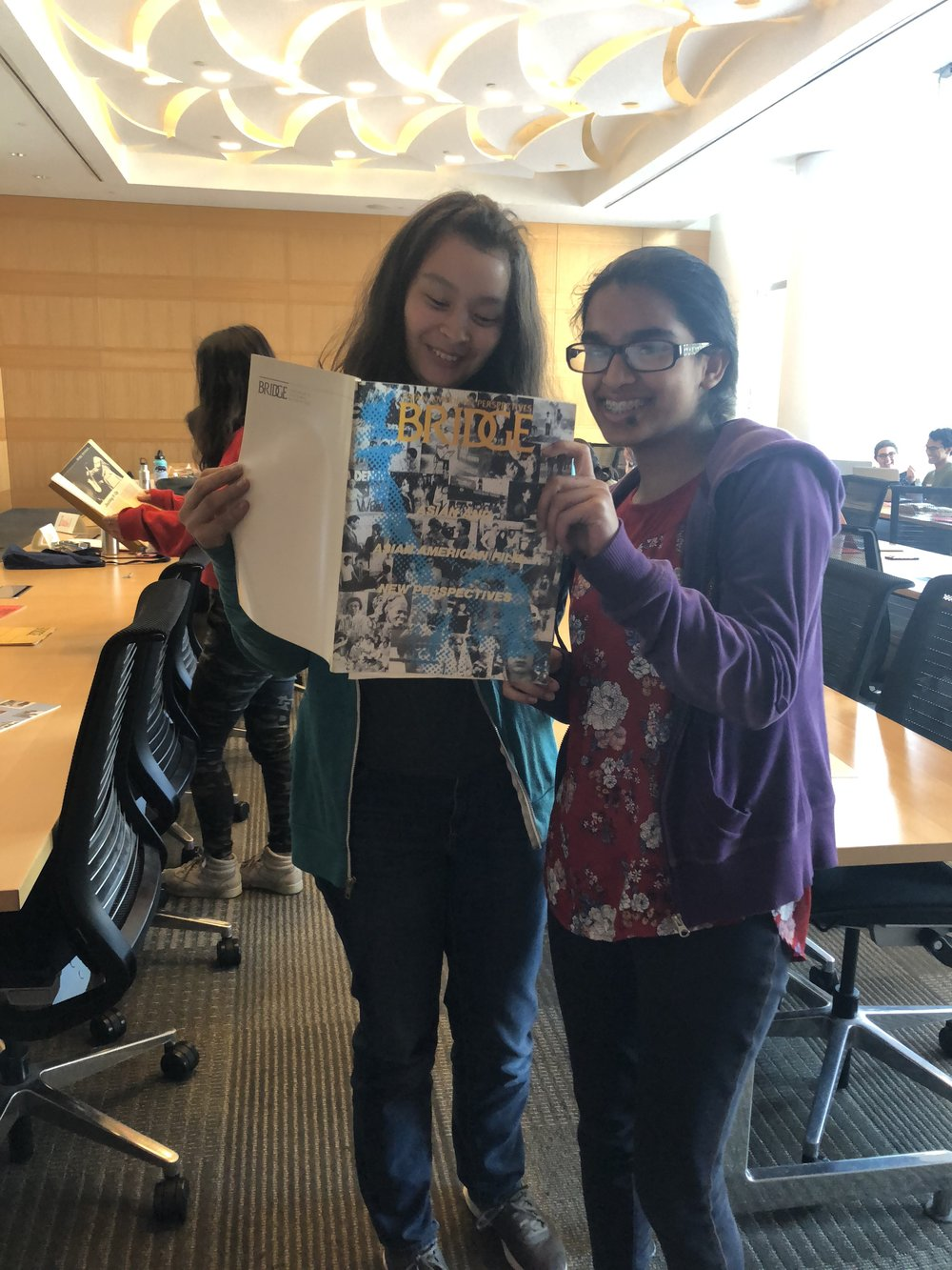 Simi with Chloe Chupungco (left), reading through  Bridge  magazine!