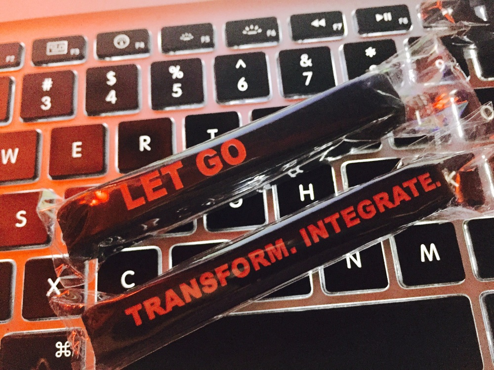 One side says LET GO. Other side says TRANSFORM. INTEGRATE. I inspected it and they are very high quality.