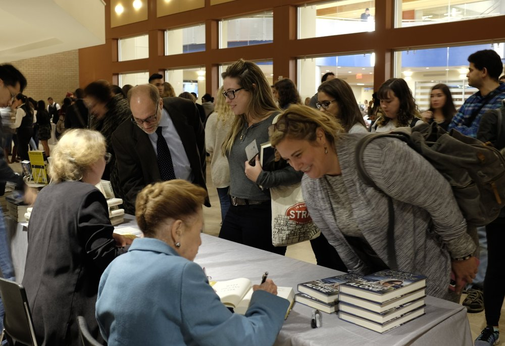 Audience members have their books signed by A.S. King and Mary Higgins Clark following the address.