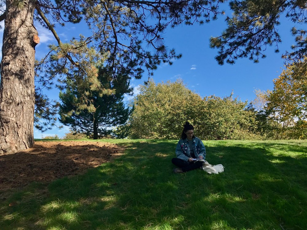 Nadine Santoro, FCRH '18, takes time to reflect and write in the New York Botanical Garden.