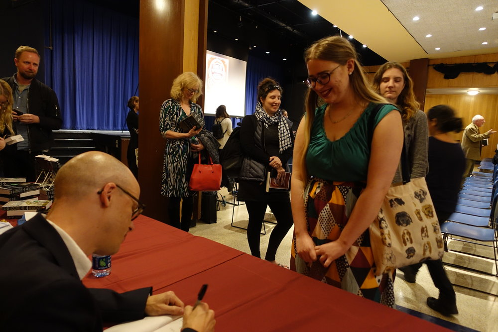 Lev Grossman signed copies of  The Magicians  for those in attendance of his lecture.