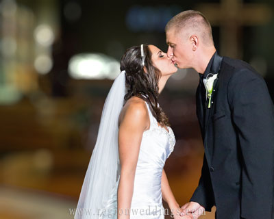 first-kiss-bride-groom-church.jpg