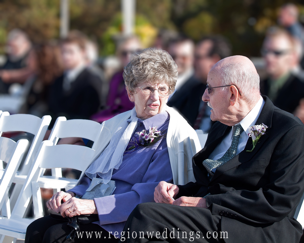 Grandparents of the bride await the start of the outdoor wedding ceremony at Marquette Park Pavilion in Gary, Indiana.