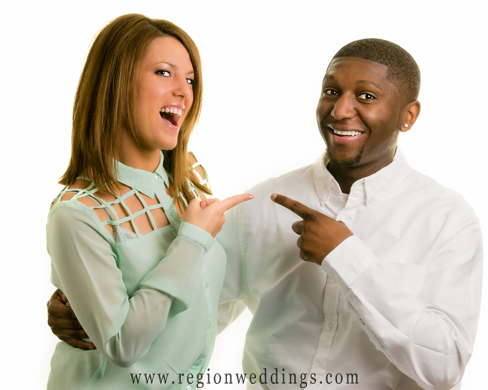 A fun loving bride to be and her fiancé laugh it up at the Region Weddings Crown Point portrait studio.