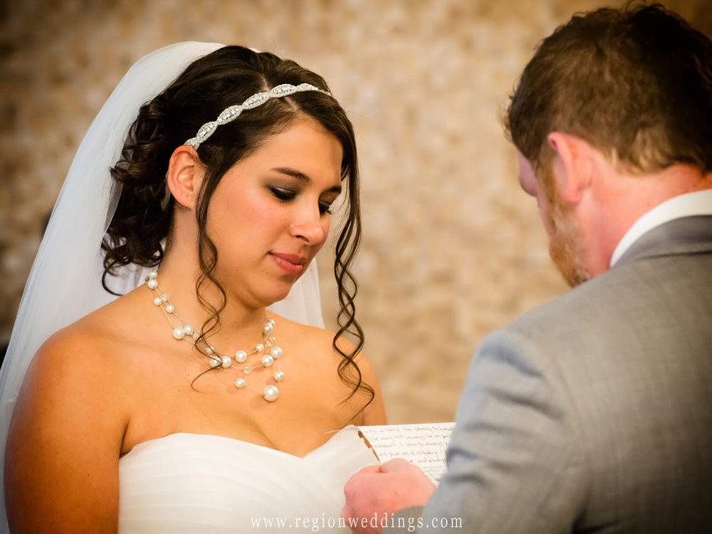 A groom tears up as he reads how vows to his bride during their wedding ceremony at The Allure in Laporte, Indiana.
