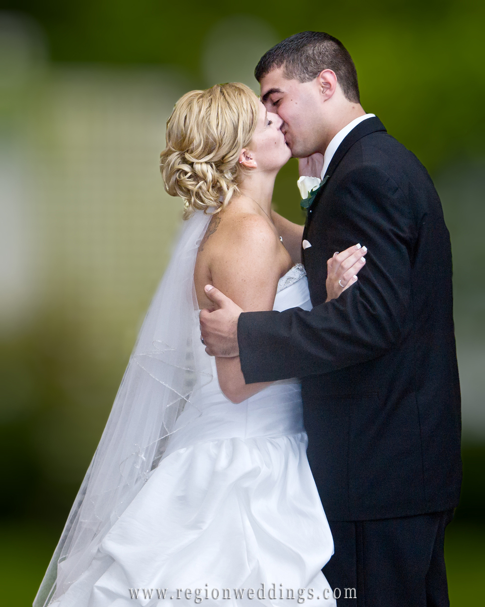 First kiss at an outdoor wedding in Portage, Indiana.