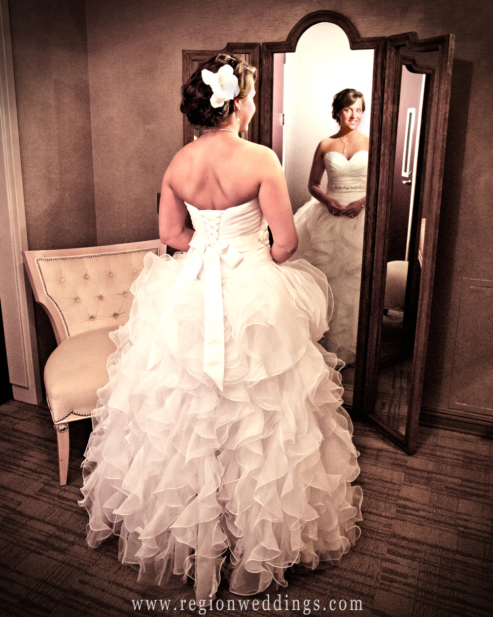A bride poses for her wedding photo in a vintage mirror inside the bridal suite at the Center for Performing Arts in Munster, Indiana.