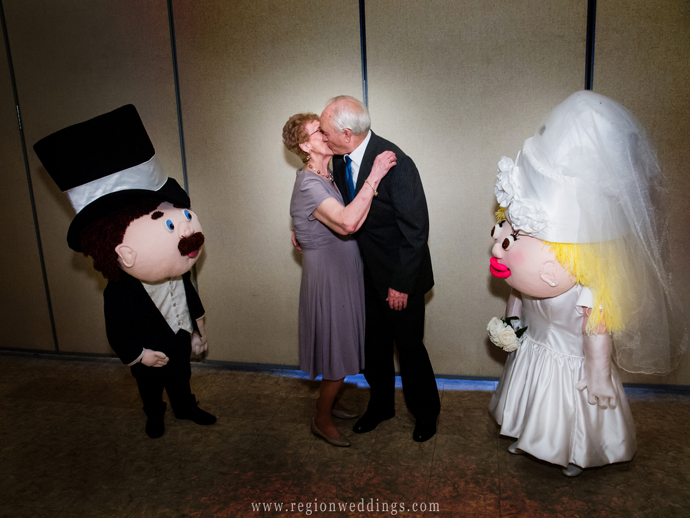 An anniversary kiss on the dance floor for a couple celebrating 60 years together.