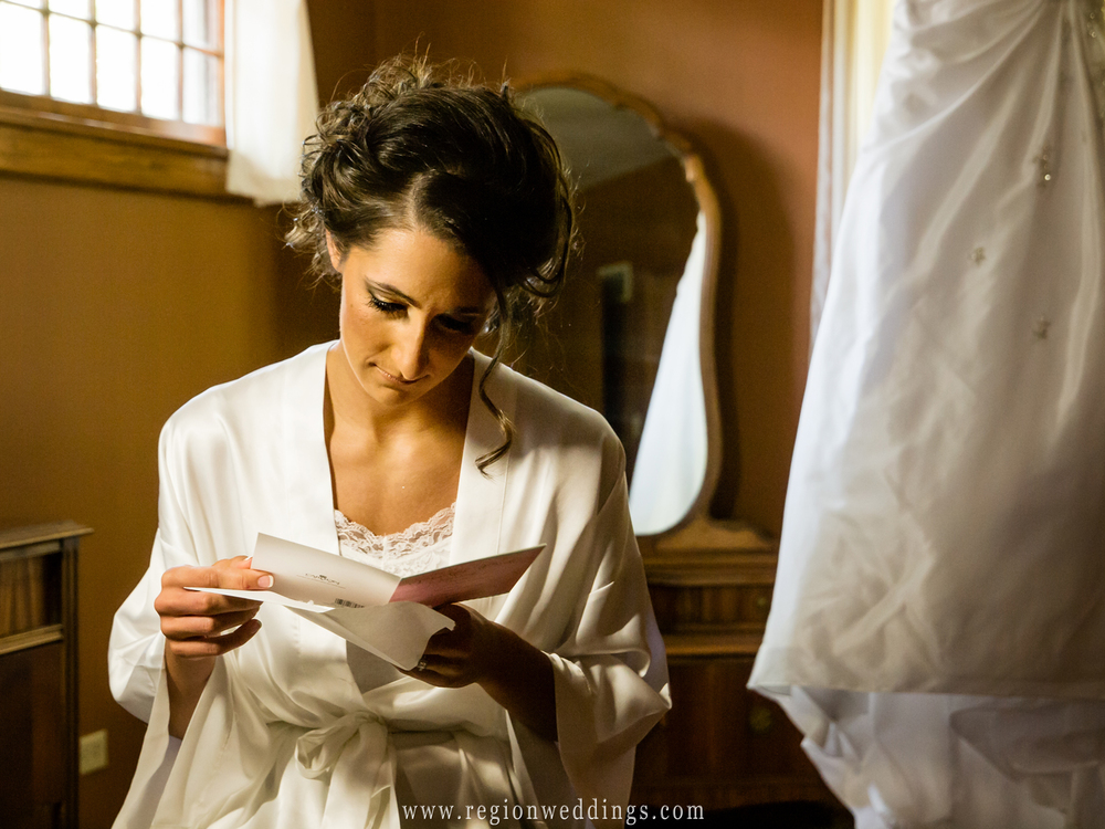 Bride reads a letter from her soon to be husband as she gets ready for her wedding.