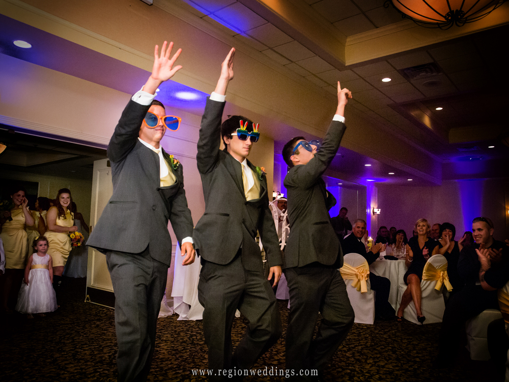 Groomsmen are introduced at the Banquets of St. George in Schererville at a June wedding reception.